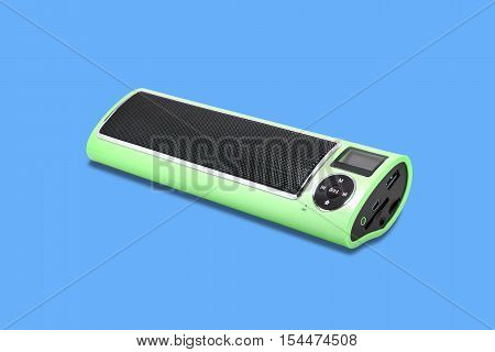 Wireless Bluetooth loudspeaker mp3 player and radio for computer notebook and smart phone on blue background.