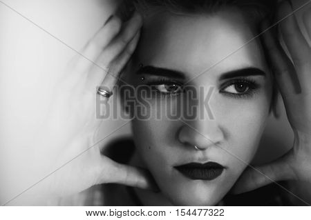 Black And White Portrait Of A Girl's Face Close Up. Girl Holding Hands Face Sereznou Expression. Bla