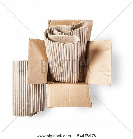 Open cardboard box and corrugated role. Packaging material. Objects group isolated on white background with clipping path. Top view flat lay