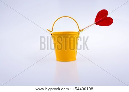 Little red color heart shape and yellow color bucket