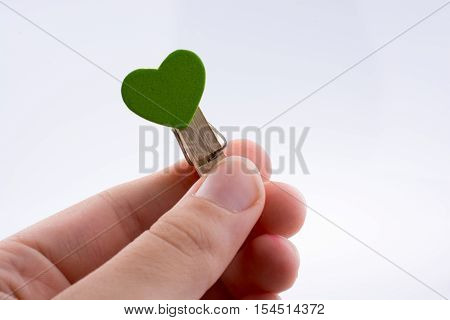 Clothespin with a green color heart icon