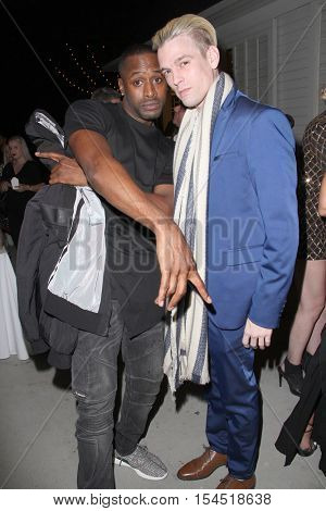 Aaron Carter (r) and a guest at the