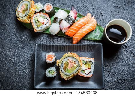 Sushi With Soy Sauce On Black Rock