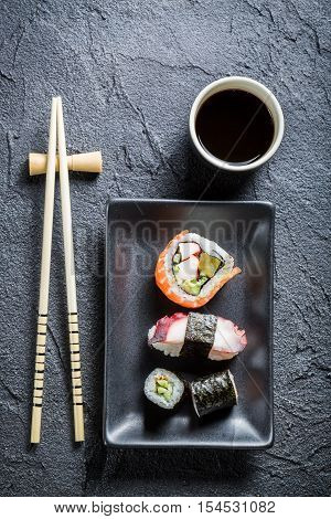 Sushi Served On A Black Ceramic With Soy Sauce