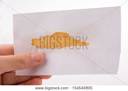 Hand Holding Torn Notepaper In Hand