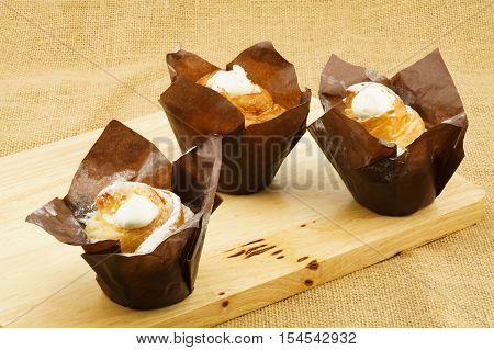 Closeup of cruffin creme brulee on a wood board place on sackcloth