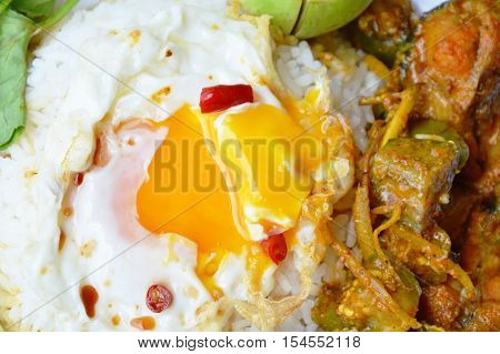 creamy yolk dressing chili fish sauce and spicy catfish curry on rice