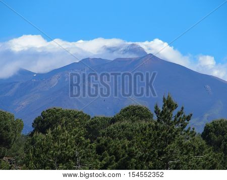 Fuming Etna in summer, the tallest active volcano in Europe, Sicily, Italy