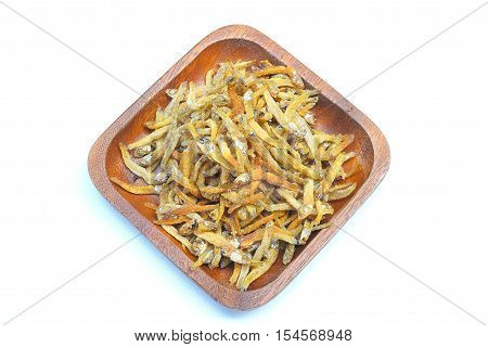 Dry small fish in bowl on white background
