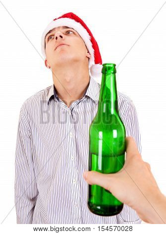 Young Man in Santa Hat refuse a Bottle of the Beer on the White Background