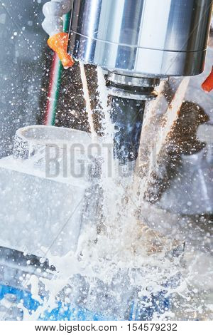 Milling metalworking process. Industrial CNC machining of metal detail by cutting end-tooth vertical mill at factory