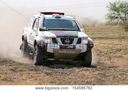 Front View Close-up Of Racing Black And White Nissan Navara Rally Car
