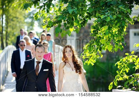 Young Bride And Groom And Their Wedding Guests