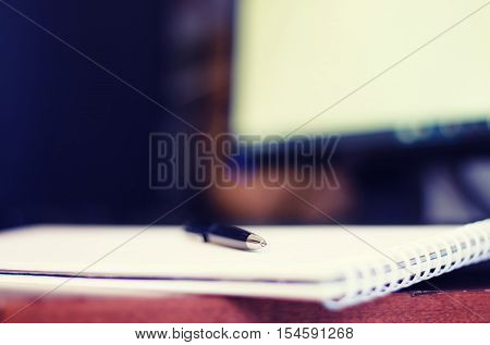 bearded man sitting at a table and working with a laptop