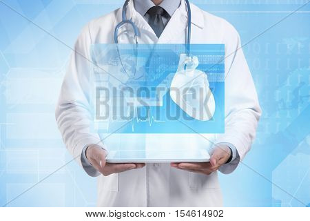 Cardiologist holding tablet. Projection of screen. Medicine and modern technology concept.