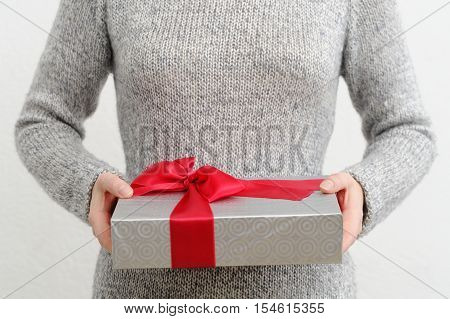 Woman Holding Gift Box, Focus On Foreground.