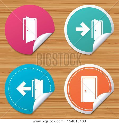 Round stickers or website banners. Doors icons. Emergency exit with arrow symbols. Fire exit signs. Circle badges with bended corner. Vector