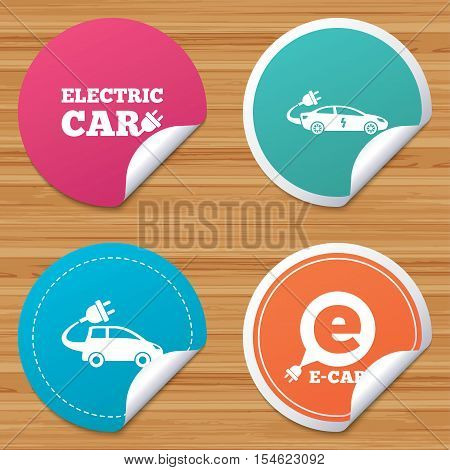 Round stickers or website banners. Electric car icons. Sedan and Hatchback transport symbols. Eco fuel vehicles signs. Circle badges with bended corner. Vector