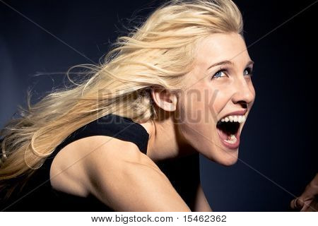 young blond woman screaming,  studio shot