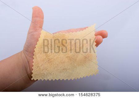 Yellow Color Mini Handkerchief In Hand