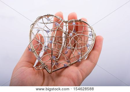 Heart Shaped Cage In Hand