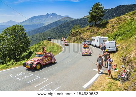 Col D'AspinFrance- July 152015: Cochonou Caravan during the passing of the Publicity Caravan on the Col d'Aspin in Pyerenees Mountains in the stage 11 of Le Tour de France 2015.Cochonou is an important French brand of short dry sausages.