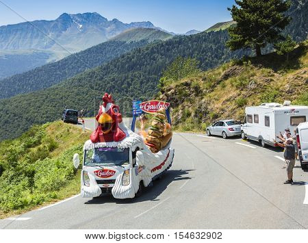 Col D'AspinFrance- July 152015: Le Gaulois vehicle during the passing of the Publicity Caravan on the Col d'Aspin in Pyerenees Mountains in the stage 11 of Le Tour de France 2015.Le Gaulois is an important French producer of poultry meat products.
