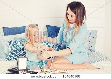 Mother and daughter with female accessories. Lovely Family
