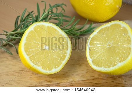 sliced lemons on a cutting board - Stock Photo