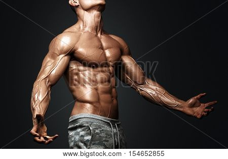 Strong Athletic Man Fitness Model Torso showing six pack abs. isolated on black background with clipping path