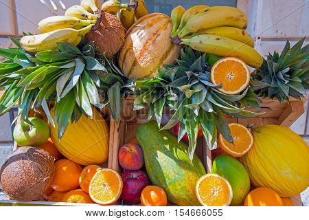 Pile of tropical fruits with bananas, pineapples, coconuts and many more