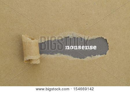 Nonsense word written under torn paper .