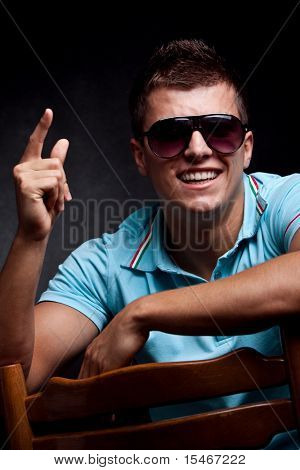 young smiling man portrait with sunglasses, studio shot