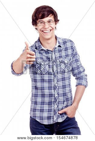 Young hispanic man wearing glasses, blue shirt with rolled up sleeves and jeans showing thumb up hand gesture and smiling isolated on white background - success concept
