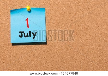July 1st. Day 1 of month, color sticker calendar on notice board. Summer time. Empty space for text.