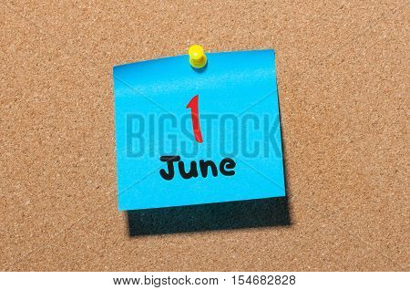 June 1st. Day 1 of month, color sticker calendar on notice board. Summer time. Close up.