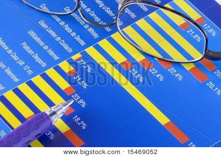 a colorful business chart with a pointing pen