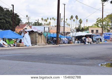 October 28, 2016 in Pomona, CA:  Row of tents also known as Tent City where homeless people reside at an impoverished inner city neighborhood and where homeless people are allowed to stay taken in Pomona, CA