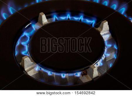 gas burner is lit on the kitchen