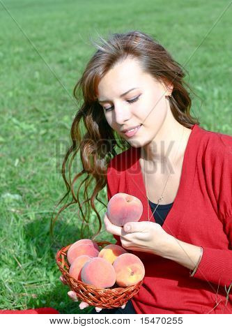 Attractive Girl With Peaches