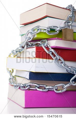 stack of colorful books protected with a chain (over a white background)