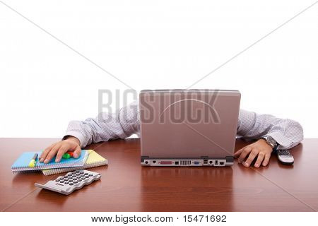 businessman sleeping behind his laptop