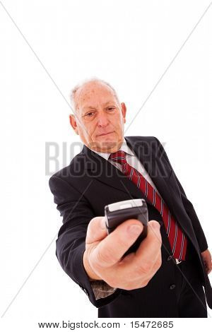 senior businessman sending a text message with his mobile phone