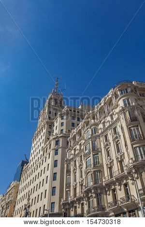 MADRID, SPAIN - MARCH 16, 2016: Building in Gran Via in Madrid Spain. It's the oldest and main shopping street in Madrid. Today the street is known as the Spanish Broadway.