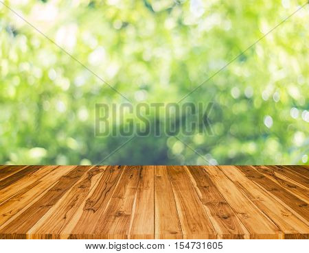 Wood Table With Blur Tree Background. Abstract Blur Background Wood Table For Display Your Product.