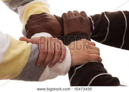 joined hand of a multiracial team (isolated on white)