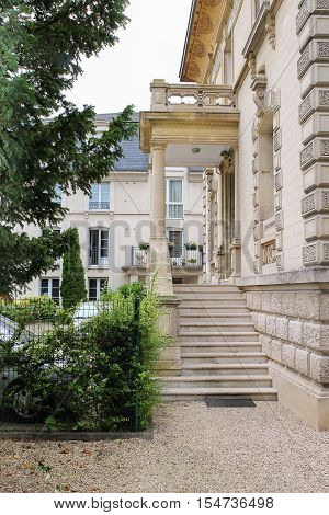 Ancient building with marble stairs balcony and porch in Chantilly Oise France