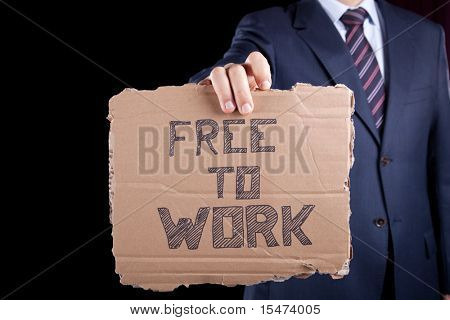 unemployed unrecognizable businessman showing a message in a cardboard that he needs a job