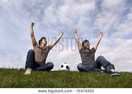 Two young men celebrating a goal from there soccer team