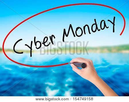 Woman Hand Writing Cyber Monday With A Marker Over Transparent Board